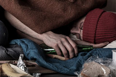 Drunk homeless man sleeping Stock Image