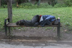 DRUNK HOMELESS SLEEPING MOLDOVA Royalty Free Stock Images