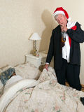 Drunk husband going to bed Stock Images