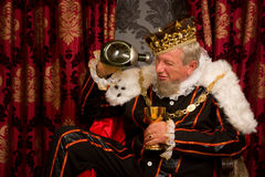 Drunk king Royalty Free Stock Images