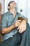 Drunk latin man sleeping on the toilet floor Stock Photography