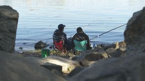 Drunk males falling asleep while fishing, tiring leisure activity, exhaustion. Stock footage stock footage