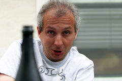 Drunk man. Mature man seems to be completely drunk Stock Photos