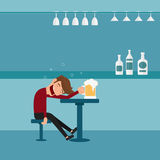 A drunk man asleep at the bar in the night club.Man relaxing in a bar. Royalty Free Stock Images