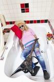 Drunk man asleep in bathtub Stock Images