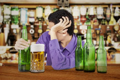 Drunk man in the bar Royalty Free Stock Image