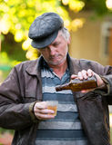 Drunk man with bottle of beer and glass Royalty Free Stock Photo