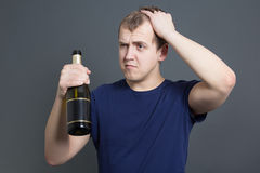 Drunk man with bottle of champagne Stock Photo