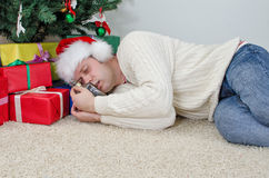 Drunk man with bottle sleeps Royalty Free Stock Photography