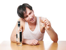 Drunk man with bottle of vodka and glass Royalty Free Stock Photos