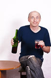 Drunk man with bottle of wine Stock Photos