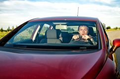 Drunk man in a car. Drunk man driving a red car Royalty Free Stock Photos