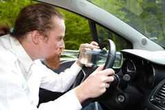 Drunk man in car. With a bottle alcohol Stock Photography