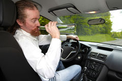 Drunk man in car royalty free stock photo