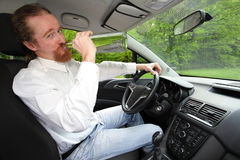 Drunk man in car. With a bottle alcohol Stock Photos