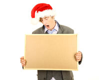 Drunk man in Christmas hat with cork board Royalty Free Stock Images