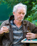 Drunk man drinking beer Royalty Free Stock Images