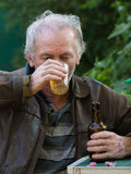 Drunk man drinking beer Stock Image