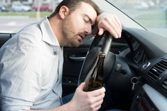 Drunk man driving car and falling asleep. At the wheel Royalty Free Stock Photos