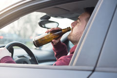 Drunk man driving car and falling asleep Royalty Free Stock Photography