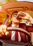 Drunk man driving a car vehicle. Royalty Free Stock Photo