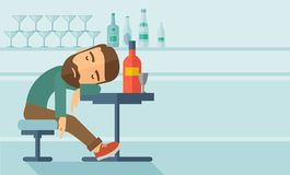 Drunk man fall asleep in the pub. A drunk man sitting fall asleep on the table with a bottle of beer inside the pub. Over drink concept. A contemporary style Royalty Free Stock Image