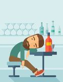 Drunk man fall asleep in the pub. A drunk man sitting fall asleep on the table with a bottle of beer inside the pub. Over drink concept. A contemporary style Royalty Free Stock Photos