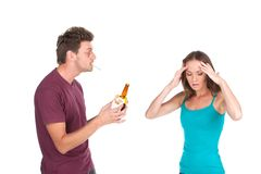 Drunk man gives alcohol to girl. Stock Photos