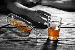Drunk man with a glass of brandy. In the pub Royalty Free Stock Photos