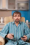 Drunk man with glass and remote Royalty Free Stock Images