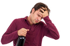 Drunk man with headache Stock Image