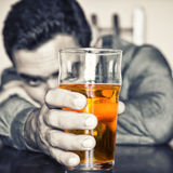 Drunk man holding a glass of beer Royalty Free Stock Images