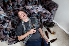 Drunk Man at home. Image of mature man falling asleep drunk from home party Stock Images