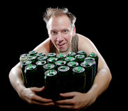 The drunk man and is a lot of empty beer cans Royalty Free Stock Images