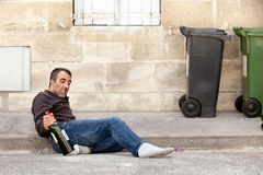 Drunk man lying Royalty Free Stock Photo