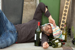 Drunk man lying Royalty Free Stock Image