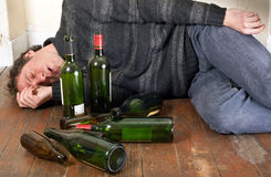 Drunk man lying Stock Photo