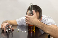 Drunk man. Drunk male lying on a table Royalty Free Stock Photos
