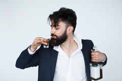 Drunk man with messy hair drinking whiskey royalty free stock photos