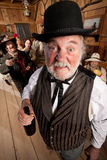 Drunk Man in an Old West Saloon Stock Images