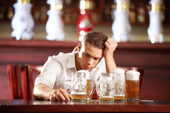 Drunk man in a pub. Drunk man with a beer in a pub Royalty Free Stock Image