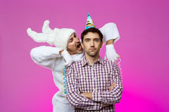 Drunk man and rabbit at birthday party over purple background. Stock Photos