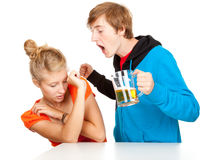 Drunk man shouting and striking girlfrien. Violence  - young couple is arguing, drunk men shouting and striking girlfriend Royalty Free Stock Photos