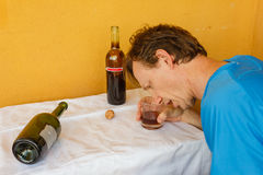 A drunk man shumped  on the table Royalty Free Stock Photography