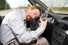 Drunk man sitting in drivers stock photo