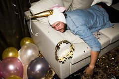 Drunk man sleep on a sofa Royalty Free Stock Photos