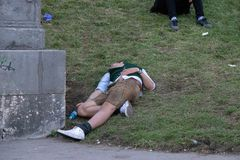 Drunk man sleeping at the Bavaria, Oktoberfest, Munich royalty free stock photography