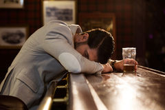 Drunk man sleeping on a pub counter Stock Photo