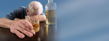 Drunk man sleeping on table after alcohol abuse Stock Photo
