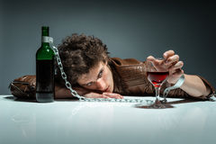 Drunk man sleeping at the table with a glass of wine Royalty Free Stock Photo